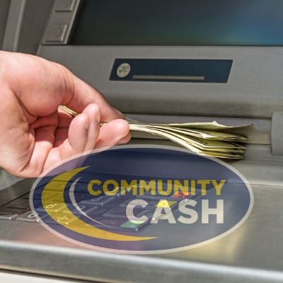 Hand receiving cash from ATM with Community Cash logo.